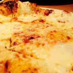 Photo taken at California Pizza Kitchen by Jonathan F. on 7/9/2013