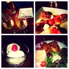Photo taken at San Pedro Square Bistro & Wine by Claudia S. on 3/30/2013