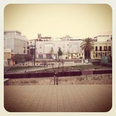 Photo taken at Plaça de la Muralla by Marcel I. on 10/27/2012