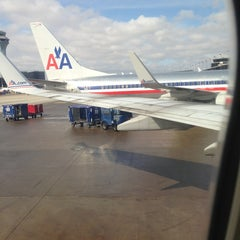 Photo taken at Gate G4 by Julianne K. on 3/17/2013