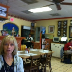 Photo taken at Azucar Restaurant & Bakery by Bill B. on 3/6/2013