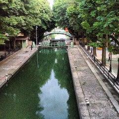 Photo taken at Canal Saint-Martin by Damaris B. on 8/12/2013