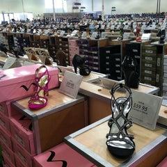 Photo taken at DSW Designer Shoe Warehouse by Foodlover S. on 3/20/2014