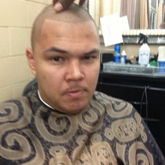 Photo taken at D'Capelli Barbershop by Marcus D. on 12/25/2012