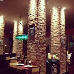 Photo taken at Divina Comédia Pizza Bar by Regiane A. on 1/14/2013