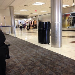 Photo taken at Gate T12 by Kim S. on 11/12/2013