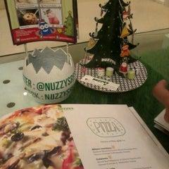 Photo taken at Nuzzy's Mousse and Resto by JeTrisha J. on 12/24/2011