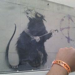 Photo taken at Banksy Mural: 'Glitter Glasses' Rat by Manu G. on 10/24/2011