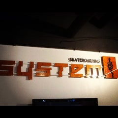 Photo taken at System Skateboards by Colorado Card on 6/26/2012