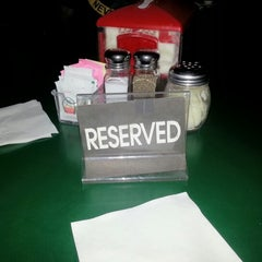 Photo taken at Pullanos Pizza & Wings by Chelsea S. on 12/2/2012