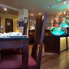 Photo taken at Asha's Contemporary Indian Cuisine by Inese P. on 11/12/2015
