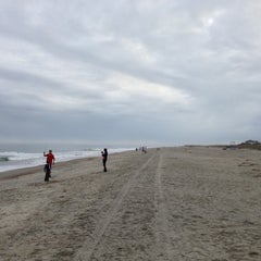 Photo taken at Tybee Curve Beach by Justin R. on 12/9/2012