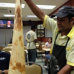 Photo taken at Original Penang Kayu Nasi Kandar by Aaron G. on 12/18/2012