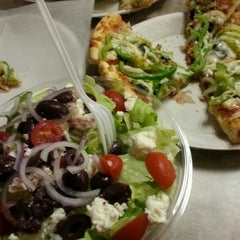 Photo taken at Singas Famous Pizza by dave b. on 12/17/2012