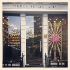 Photo taken at Pierre Hermé by Sarah B. on 11/29/2012