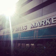 Photo taken at Beverly Hills Market & Deli by Ryo I. on 3/27/2014