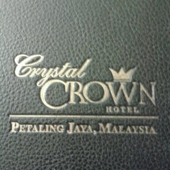 Photo taken at Crystal Crown Hotel by Jindah E. on 12/5/2012