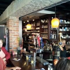 Photo taken at Metropolitan Coffeehouse & Wine Bar by Pete C. on 10/6/2011