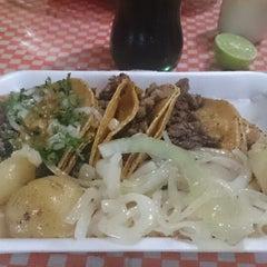 Photo taken at Tacos Palomo by Oziel H. on 3/22/2014