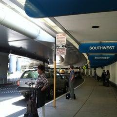 Photo taken at Terminal 1 by Christina H. on 6/13/2013