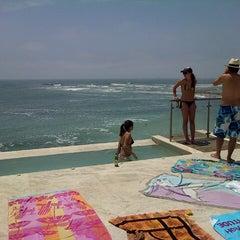 Photo taken at Playa Señoritas by Ximena O. on 1/3/2013