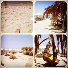 Photo taken at Ramo Beach by Suna E. on 7/15/2013