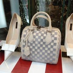 Photo taken at Louis Vuitton by Sofia F. on 4/7/2013