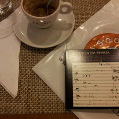 Photo taken at Figaro Café by Fernando M. on 5/18/2013
