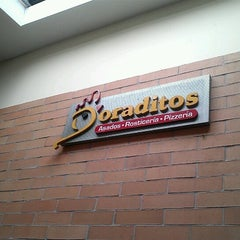 Photo taken at Doraditos by Charlie C. on 12/7/2012