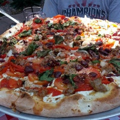 Photo taken at Grimaldi's Coal Brick-Oven Pizzeria by Andy B. on 9/15/2012