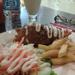 Photo taken at Solaria by stenly a. on 12/5/2014