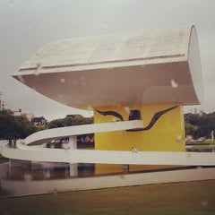 Photo taken at Estacionamento Museu Oscar Niemeyer by Cris B. on 6/12/2015