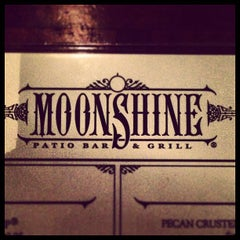Photo taken at Moonshine Patio Bar & Grill by Chuck P. on 3/8/2013