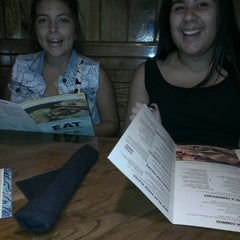 Photo taken at Outback Steakhouse by Alicia M. on 7/28/2013