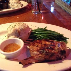 Photo taken at Outback Steakhouse by G S. on 12/21/2012