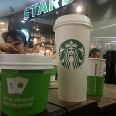 Photo taken at Starbucks by Kutay U. on 5/17/2013