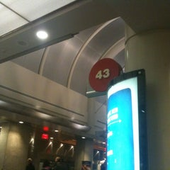 Photo taken at Gate 43 by Travis H. on 12/17/2012