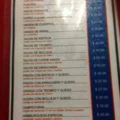 Photo taken at Tacos El Güero by Andrea J. on 1/4/2013