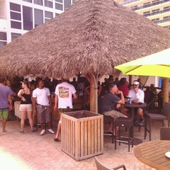 Photo taken at Bamboo Beach Tiki Bar & Cafe by Michael O. on 6/29/2013