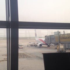 Photo taken at Gate A6 by Khairulg on 10/7/2014