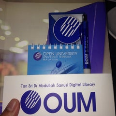 Photo taken at Tan Sri Dr. Abdullah Sanusi Digital Libray, Open University Malaysia (OUM) by Fawwaz K. on 11/13/2014