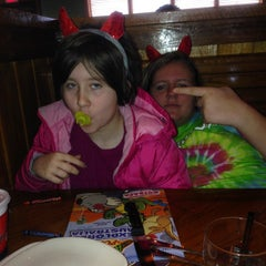 Photo taken at Outback Steakhouse by Aaron T. on 12/28/2014