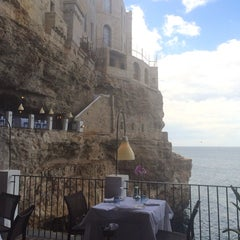 Photo taken at Grotta Palazzese by Buket D. on 5/23/2015