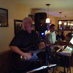 Photo taken at Fitzgerald's Dango's Steak House, Irish Pub & Sports Bar by Stephanie R. on 3/9/2014