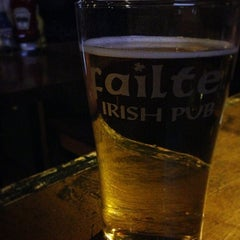 Photo taken at Failte Irish Pub by Michelle K. on 4/26/2015