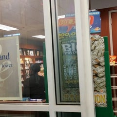 Photo taken at Newsstand @ Centennial Towers by Jason S. on 1/16/2014