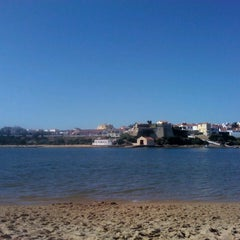 Photo taken at Praia de Vila Nova de Milfontes by André B. on 7/31/2013