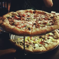 Photo taken at Mellow Mushroom by Claudio P. on 1/13/2013