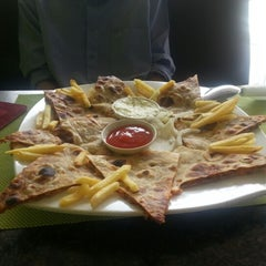 Photo taken at Ar-Rayan Arab Restaurant by Liza A. on 2/6/2013