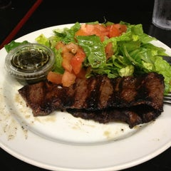 Photo taken at Renzo's Gourmet, South Tampa by Javier F. on 1/13/2013
